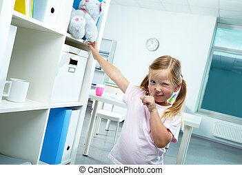 Funny girl - Portrait of funny girl keeping forefinger by...