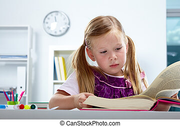 Knowledge - Portrait of lovely girl reading big book in...