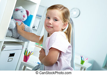 Cute child - Portrait of lovely girl touching her favourite...