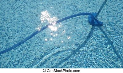 House of cleaning machine working in pool under water