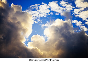 Storm clouds on a blue sky