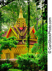 Jungle temple - Cambodian temple surrounded by green foliage...