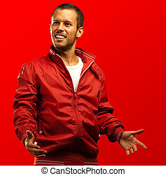 young man with red jacket on a red background