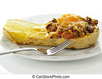 stuffed squash with cheese on a plate with fork