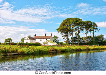 Lancaster canal scenic - Scenic view of a whitewashed house...