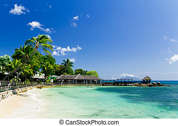 Blue lagoon and a pier in tropical resort, Seychelles -...