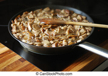 delicious fried mushrooms in a skillet - delicious fried...