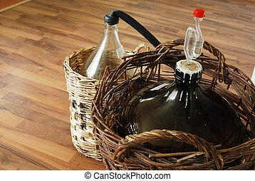 bottles of homemade wine in wicker baskets