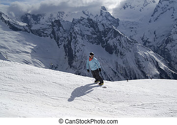 Snowboarder on ski slope