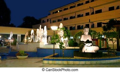 Night view of the fountain and statue of Buddha in front of...