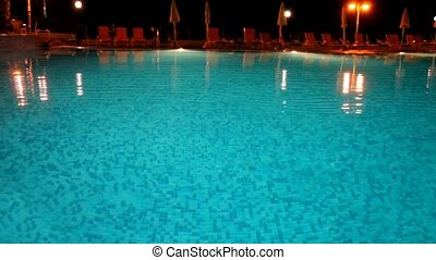 Night view of the surface of the water pool, lighted...