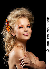 beautiful blond woman with flower garland