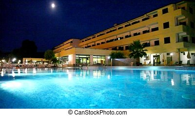 Pool in front of hotel at night