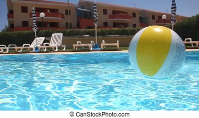 Large ball floats on water in the pool