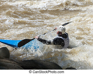 Gulp! - Competitive kayaker encountering some foam and rock