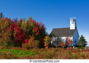 New Brunswick Autumn Church - A white church offset to the...