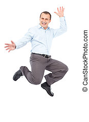 Businessman jumping for joy - Happy young businessman...