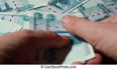 Hand recount many banknote thousand rubles - Closeup of hand...