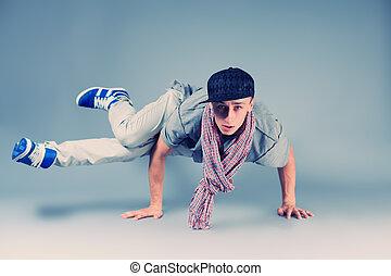 rapper - Young man dancing hip-hop at studio.