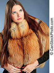 outerwear - Portrait of a beautiful young woman in a fur