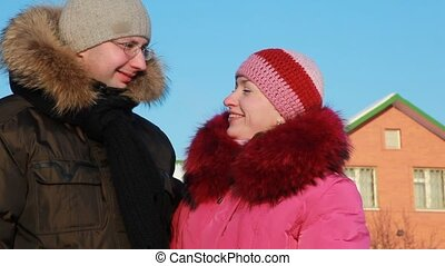 Woman and man at winter outdoors - beautiful young woman in...