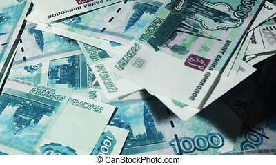 Many banknote thousand rubles turn in two levels - Closeup...