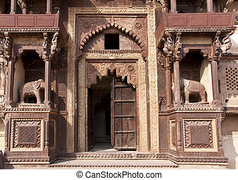 Elephants, balconies, and elaborated arches with delapidated...