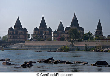 Bundela cenotaphs line across Betwe River in Indias Orchha -...