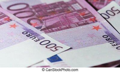 Many denominations five hundred euros rotate - Closeup many...