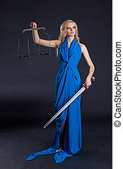 Themis - Statue of justice. Blond Woman with scale and...