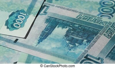 Many banknote thousand rubles bunch rotate - Closeup of many...