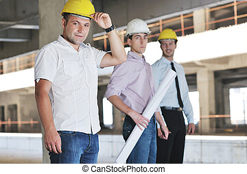 Team of architects on construction site - Team of business...