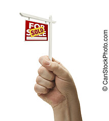 Sold For Sale Real Estate Sign In Fist On White