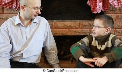 Father says his son in front of fireplace on Christmas
