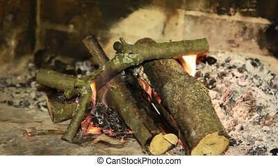 Simple fireplace with fire logs burning out to give heat -...