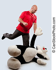 man fights with a toy animal - bald man fights with a toy...