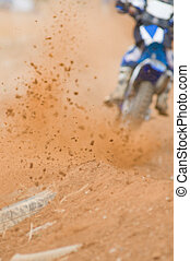 Motocross Roost - Motocross rider accelarating out of a...