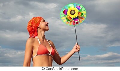 Close-up view of woman holding toy that spins on the background of sky