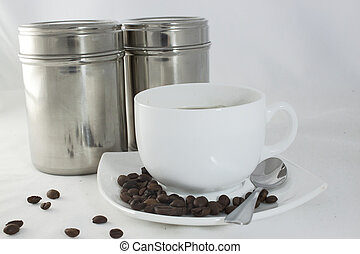 Coffee - Cup of tasty coffee and canisters