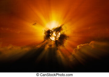 Sun behind clouds - Close up of sun shining through clouds,...