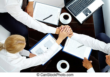 Teamwork - Image of successful partners making pile of hands...