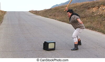 Anger old television and a baseball - Woman with anger...