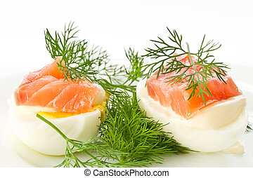 eggs and salted trout - snack of salted eggs and trout on a...