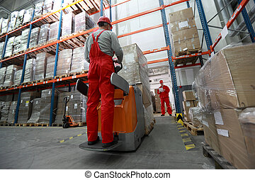 goods deliver in storehouse - Goods delivery - two workers...