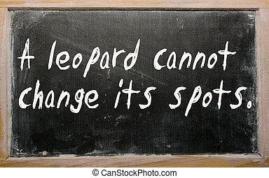 """""""A leopard cannot change its spots"""" written on a blackboard"""