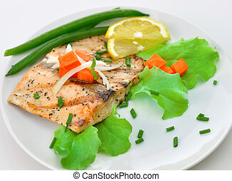grilled salmon fillet with vegetables and lemon