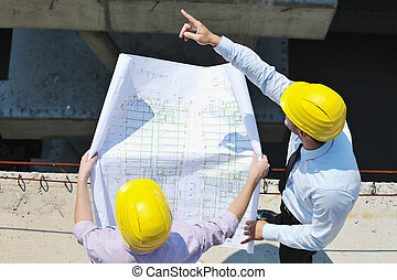 Team of architects on construction site - Team of architects...