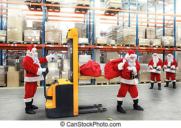 santa clauses in the line for the sacks of gifts in...