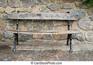 park bench against the stone wall