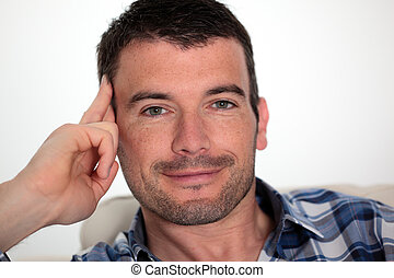 beautiful man relax on sofa at home
